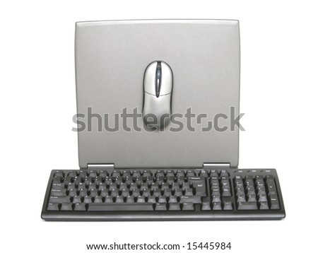 Backside of laptop monitor with keyboard and mouse - stock photo