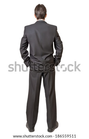 Backside of man in black suit keeping hands in pockets isolated on white background - stock photo
