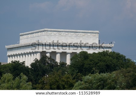 Backside of the Lincoln Memorial, partially obscured by trees, photographed September 7, 2012 - stock photo