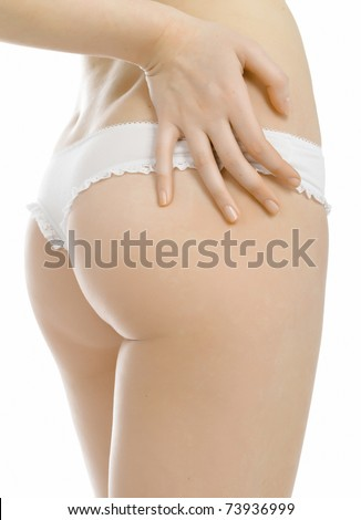Backside of young woman. Isolated on white background.