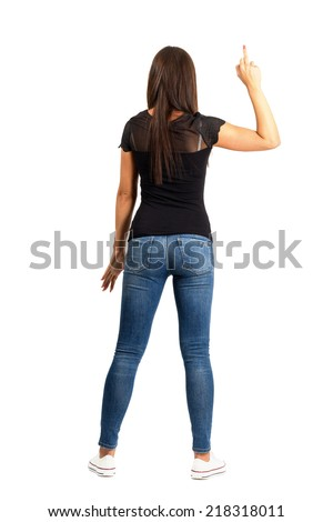 Backside view of trendy casual woman with middle finger gesture. Full body length isolated over white background. - stock photo