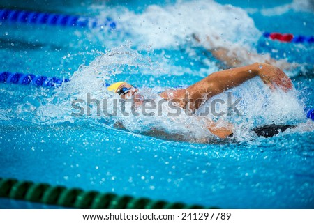 backstroke swimmer during a race on swimming pool - stock photo