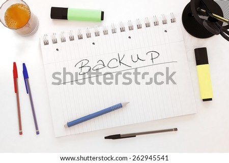 Backup - handwritten text in a notebook on a desk - 3d render illustration. - stock photo