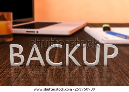Backup - letters on wooden desk with laptop computer and a notebook. 3d render illustration. - stock photo