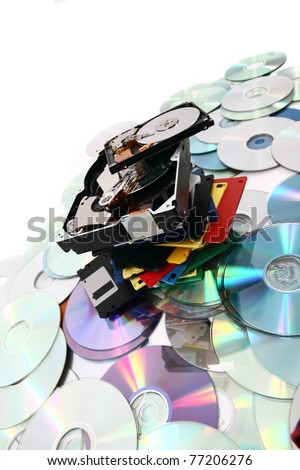 backup technology background (harddrive, floppy discs, CD, DVD) - stock photo