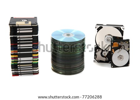 backup technology background (harddrive, floppy discs, CD, DVD) - stock photo
