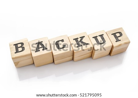 BACKUP word made with building blocks isolated on white