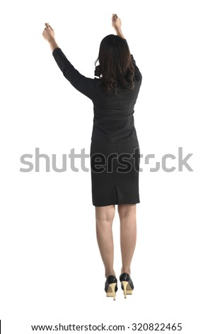 Backview of asian business man raise hand isolated over white background - stock photo
