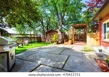 Backyard Deck With Pergola And Concrete Patio. Northwest, USA