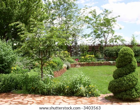 backyard garden after spring rain - landscaping in a yard - stock photo