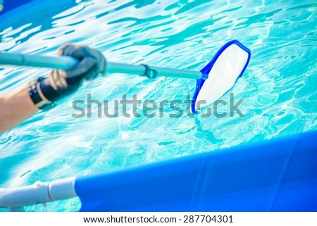 Backyard pool stock photos images pictures shutterstock for How to take care of your swimming pool