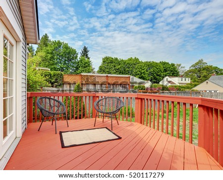 Backyard of craftsman home with red deck. Northwest, USA