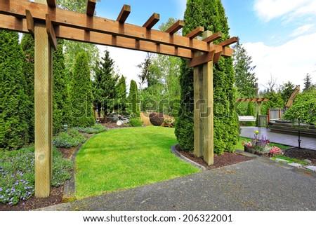 Backyard view. Entrance to garden and patio area - stock photo