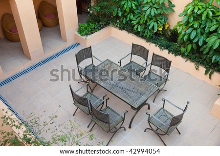 Backyard with chairs and table for resting. - stock photo