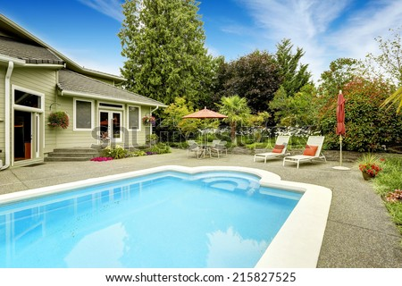 Backyard with swimming pool and patio area.Real estate in Federal Way, WA - stock photo