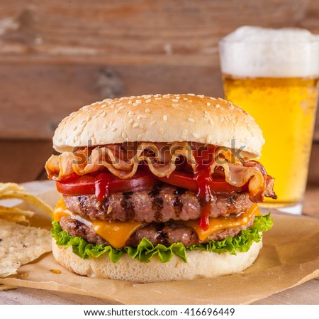 Bacon and cheese burger with grilled beef patty. tomato and onion