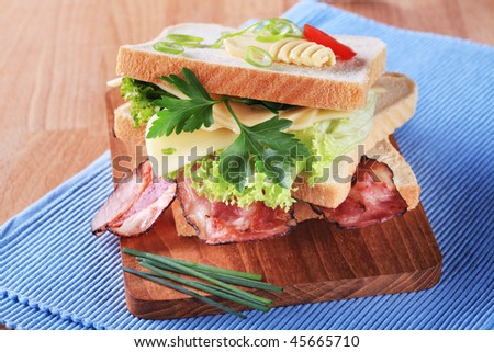 Bacon and cheese sandwich - stock photo