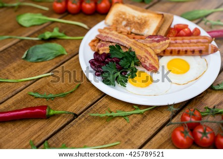 Bacon and Egg. Salted egg and sprinkled. English breakfast. - stock photo
