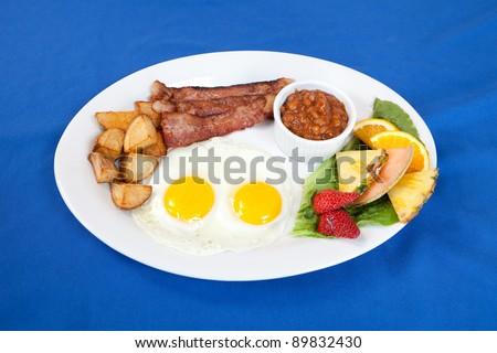 Bacon and eggs breakfast platter - stock photo
