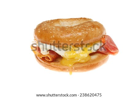 Bacon and fried egg bagel isolated against white - stock photo
