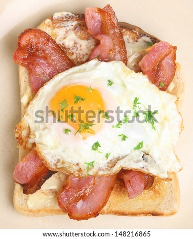 Bacon and fried egg on toast.