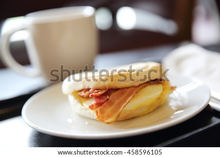 Bacon and fried egg roll with coffee - stock photo