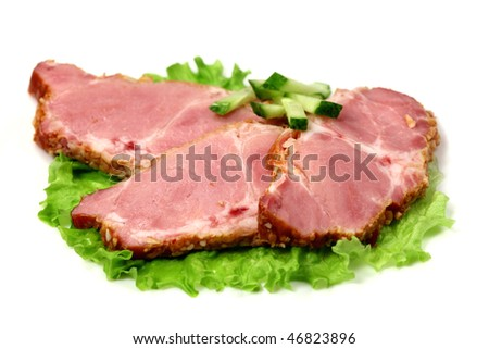 Bacon and green cucumber on lettuce