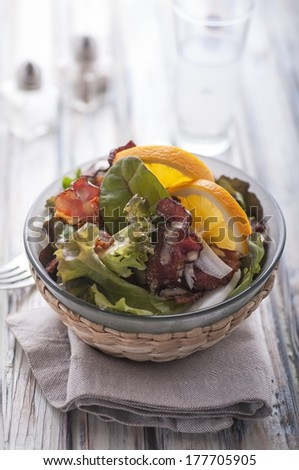 Bacon and lettuce salad on wood table - stock photo