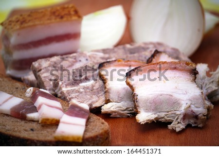 Bacon, bread, onion. - stock photo