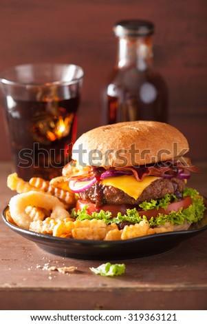 bacon cheese hamburger with beef patty tomato onion - stock photo