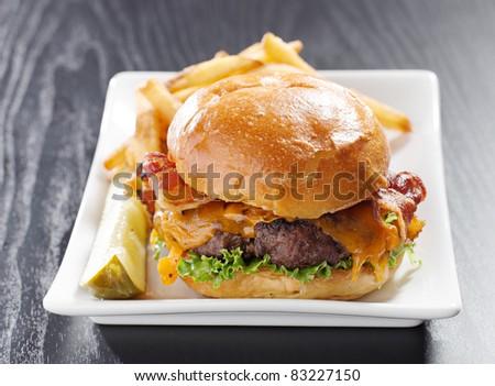 Bacon cheeseburger meal shot with selective focus - stock photo
