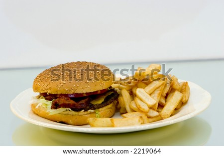bacon cheeseburger with french fries on a plate - stock photo