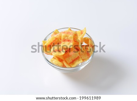 bacon crisps served in the glass bowl - stock photo