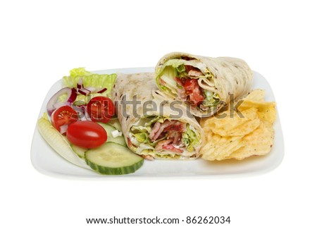 Bacon, lettuce and tomato filled bread wraps on a plate with potato crisps and a salad garnish isolated against white