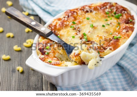 Bacon lovers' mac and cheese in baking dish - stock photo