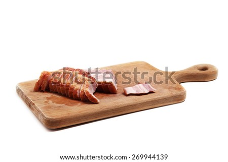 Bacon on the cutting board isolated on white - stock photo
