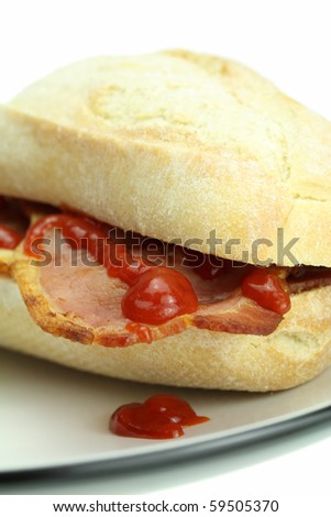 Bacon roll and tomato ketchup.
