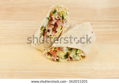 bacon, salad and blue cheese bread wraps on a wooden board