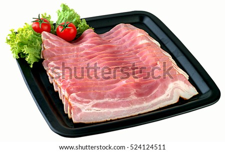 Bacon strips in black plate.Clipping path.