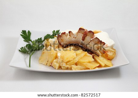 bacon with potato on white plate isolated on white background - stock photo