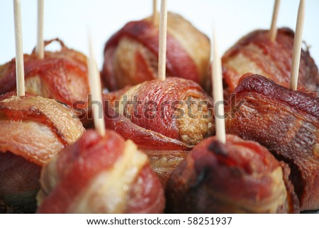Bacon Wrapped Meatballs with Toothpicks on White - stock photo