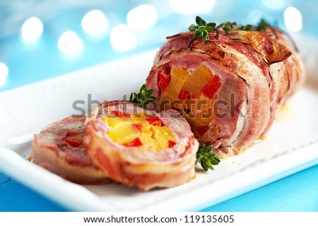 Bacon wrapped pork with pineapple and pepper - stock photo