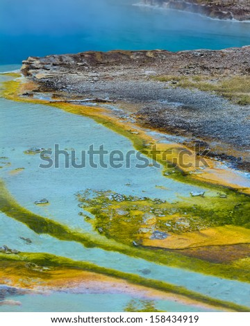 Bacterial growth in the soil of Yellowstone's Geyser Basin creating some amazing colors - stock photo