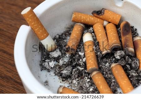 Bad addiction. Ashtray and cigarettes close-up.  - stock photo
