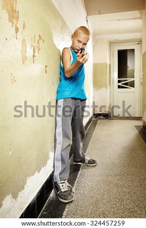 Bad boy with handgun - stock photo
