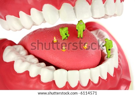 Bad breath concept. Miniature HAZMAT team inspects a tongue looking for the source of bad breath odors. - stock photo