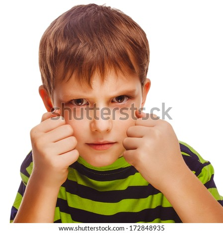bad child boy blond bully angry aggressive fights in striped green shirt isolated on white background large - stock photo