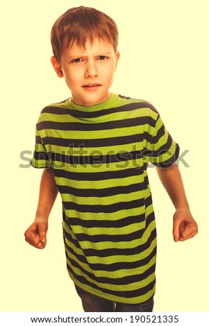 bad child boy blond bully angry aggressive fights in striped green shirt isolated on white background cross processing retro - stock photo