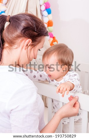 bad dreams baby looking for mum - stock photo
