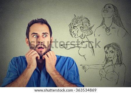 Bad evil women pointing at stressed anxious young man. Negative human emotions face expression feelings life perception. Relationship difficulties concept. Insecure weak funny looking guy  - stock photo